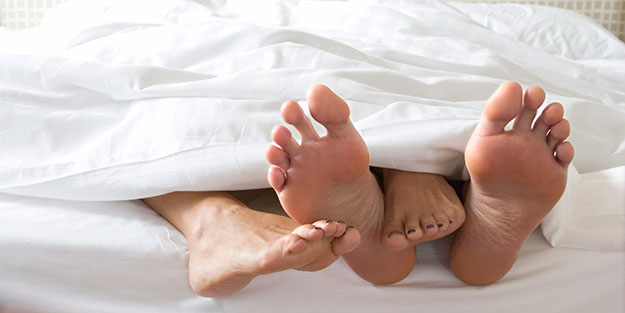 Couple-Cuddling-In-Bed