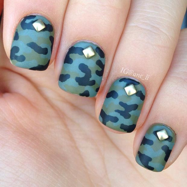 gold studs and camo nail design