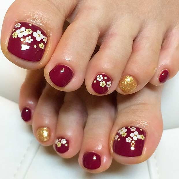 Burgundy and Gold Pedicure Design