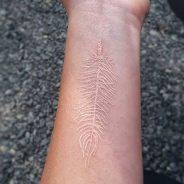 White Ink Feather Tattoo