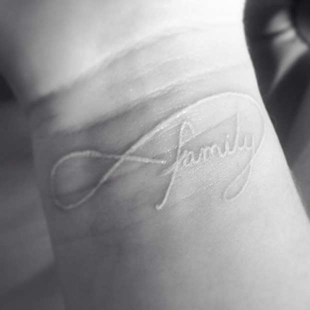 White Ink Family Infinity Wrist Tattoo