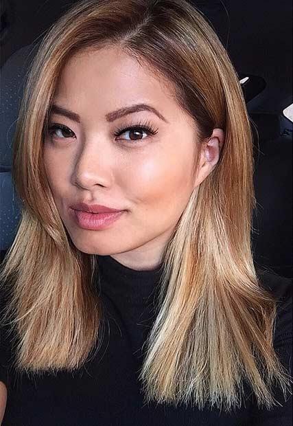 Honey Blonde Medium Haircut with Side Bangs