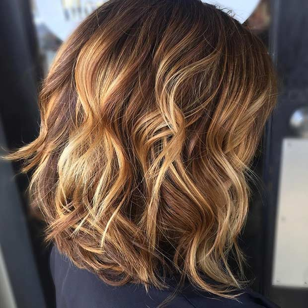 Curly Long Bob Hairstyle with Golden Highlights