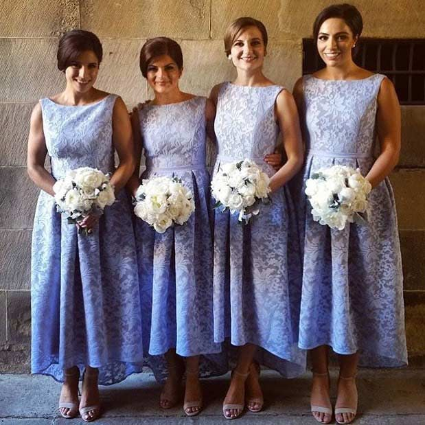Pastel Bridesmaid Dresses with White Bouquets