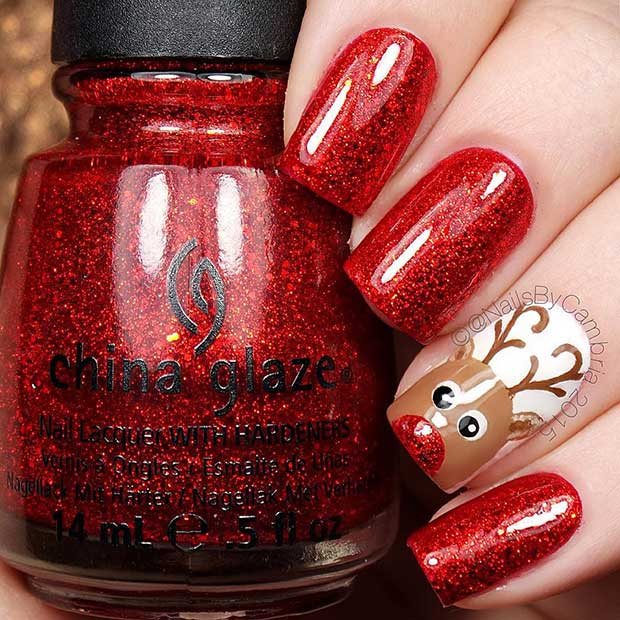 29 easy winter and christmas nail ideas page 3 of 3 stayglam red reindeer christmas accent nail prinsesfo Images