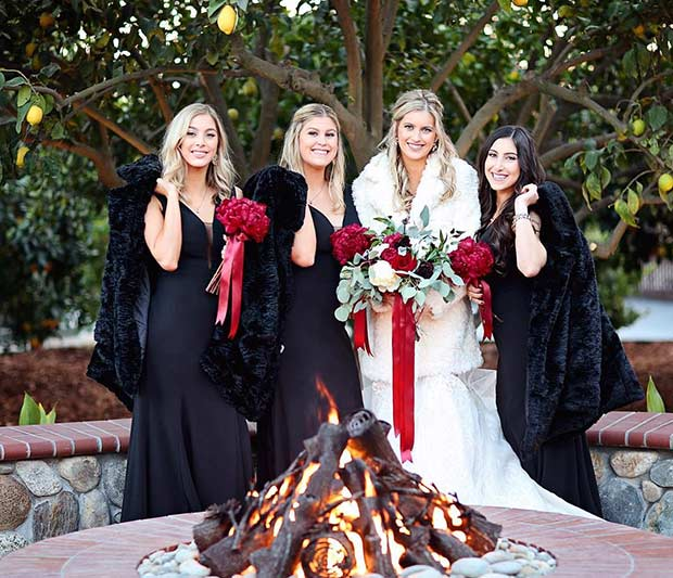 Black Winter Bridesmaid Style with Red Bouquets