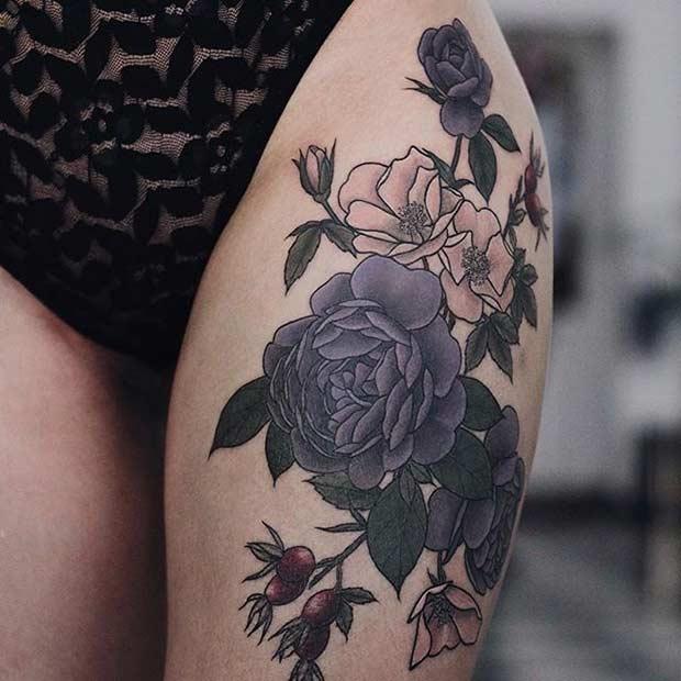 Dark Flowers Thigh Tattoo Idea