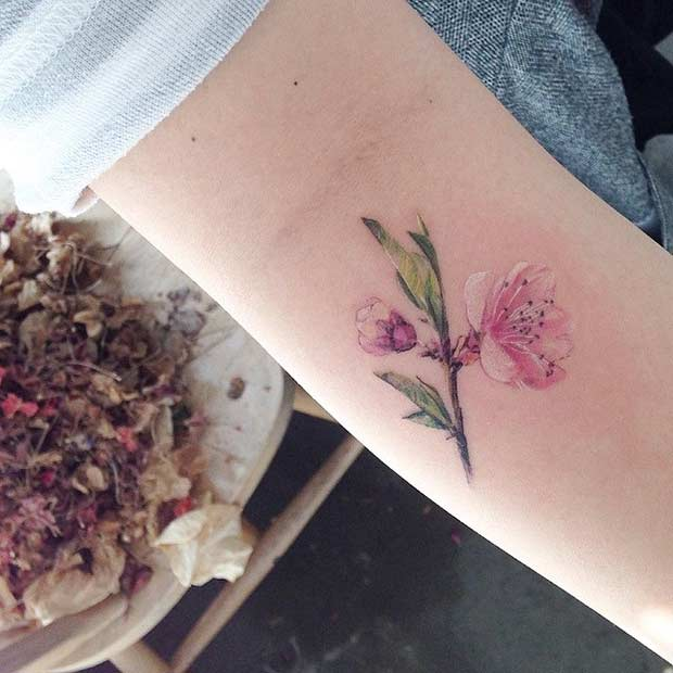 Small Watercolor Flower Arm Tattoo Idea