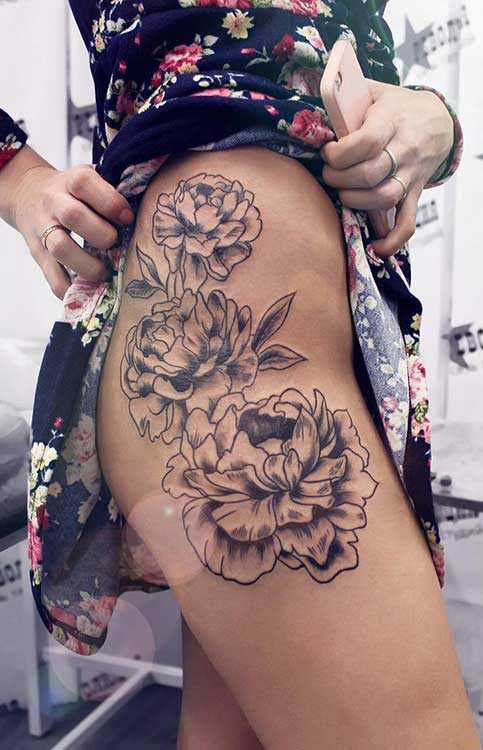 Side Thigh Flower Tattoo Idea for Women
