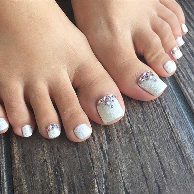 Elegant White Glitter Toe Nail Design with Rhinestones - 25 Eye-Catching Pedicure Ideas For Spring Page 3 Of 3 StayGlam