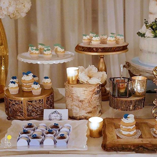 Floral Cakes on Wooden Stands for Boy's Baby Shower