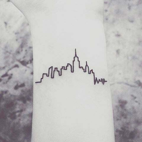 Small Skyline Tattoo Idea for Women