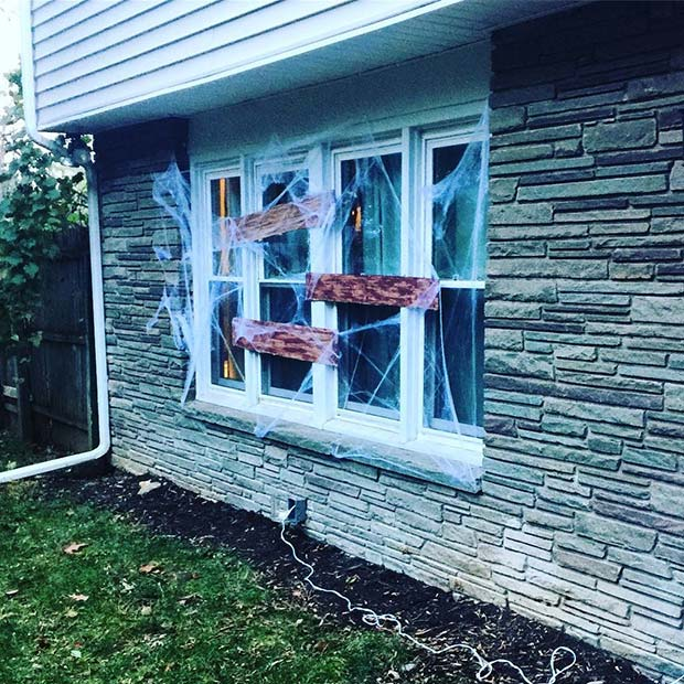 Boarded Up Haunted House Windows for DIY Halloween Decor