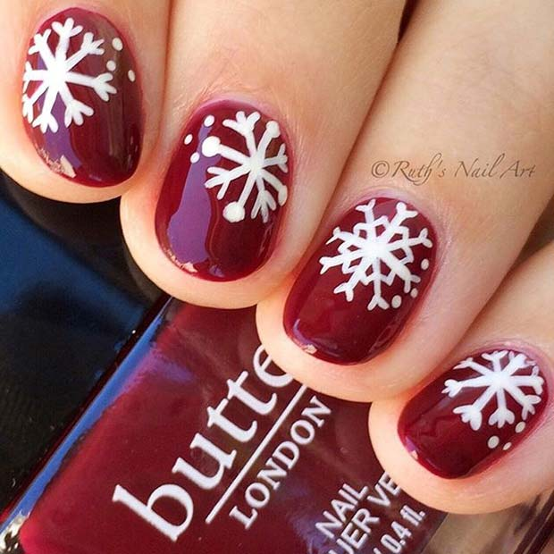 Dark Red Nails With White Snowflakes