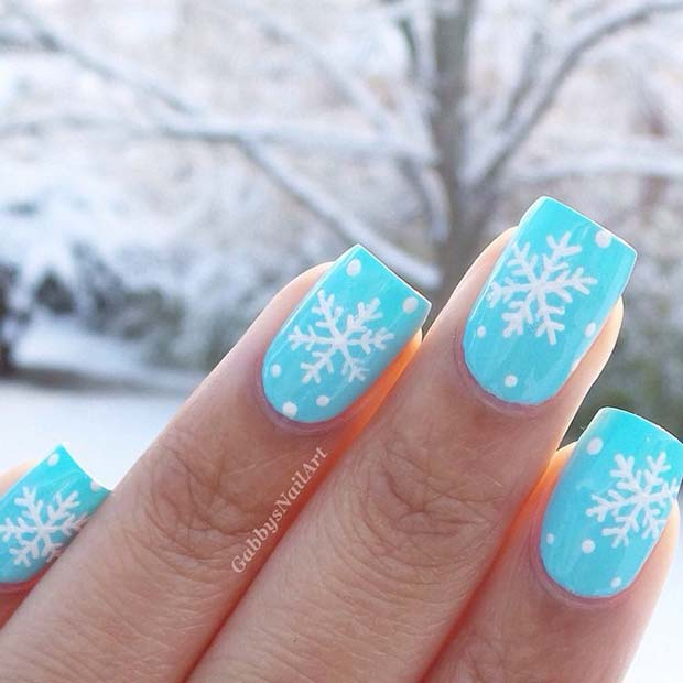 Light Blue Snow and Snowflake Nails