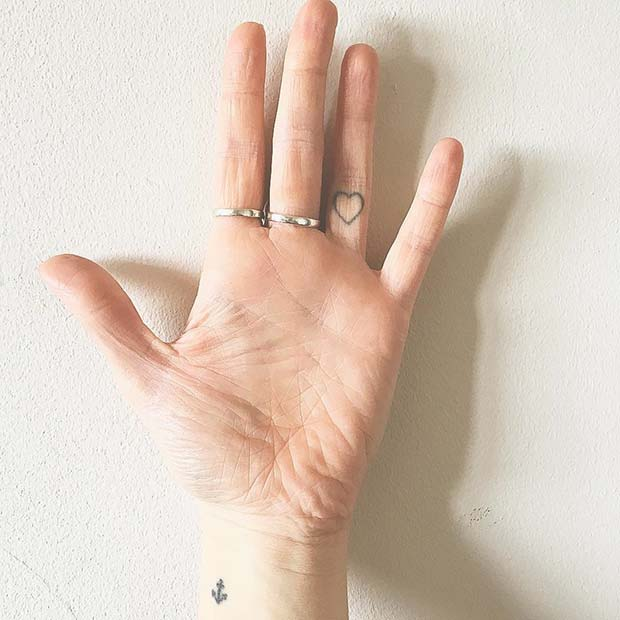 Subtle Heart Finger Tattoo