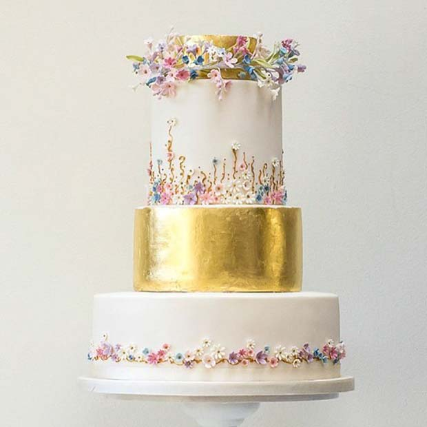 Gold Wedding Cake with Delicate Flowers