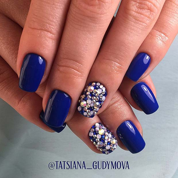 Bold Blue Nail Design with Rhinestones