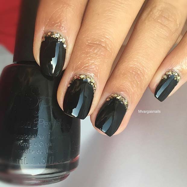 Chic Black Nails with Gold Glitter