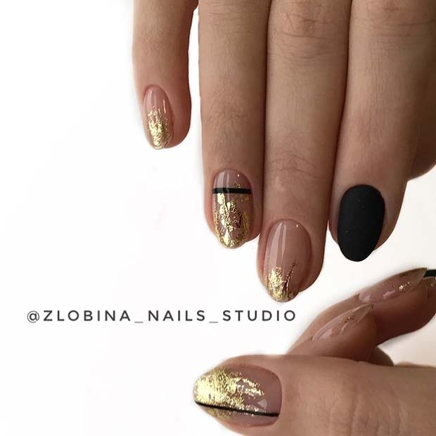 Stylish Gold Nails with Black Accent Nail