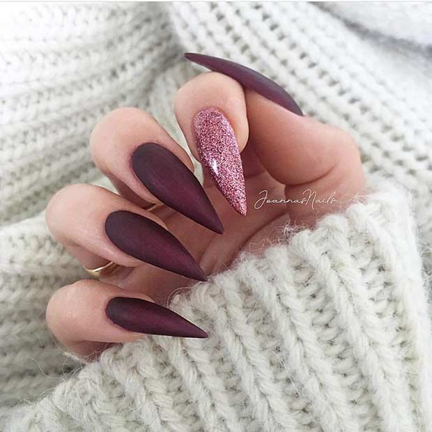 Burgundy Stiletto Nails with a Pop of Glitter