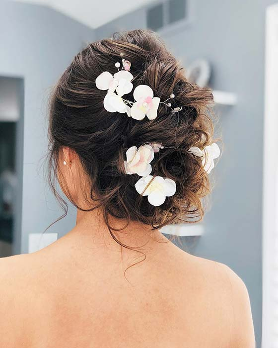 Messy, Floral Wedding Updo