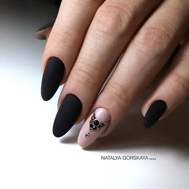 Black Matte Nails with a Sparkly Nude Accent Nail