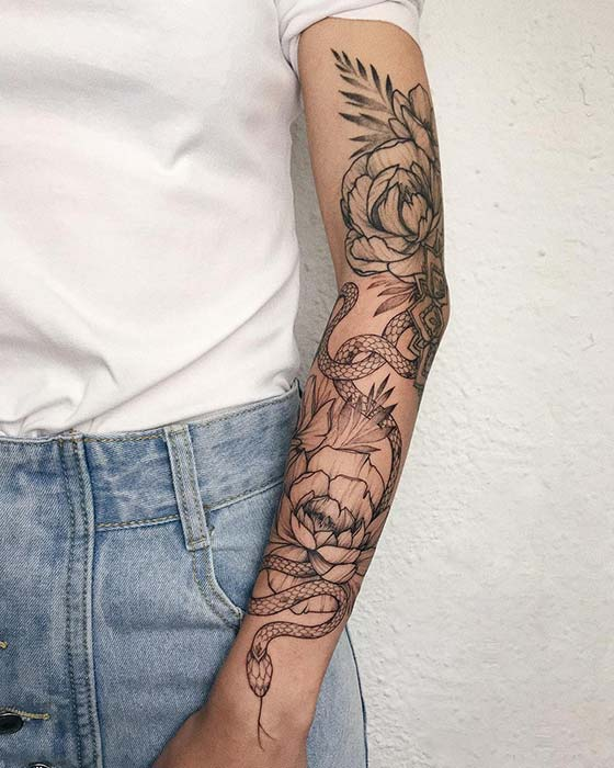 Floral Arm Tattoo with a Snake