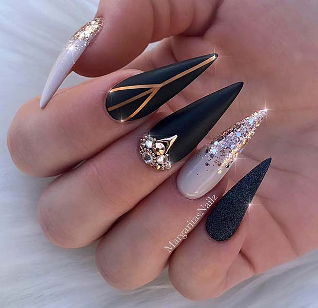 Glam Black and Gold Stiletto Nails