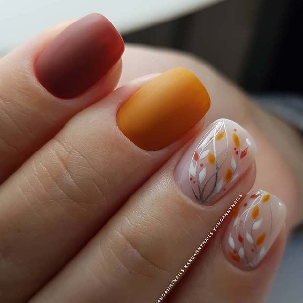 Orange and Red Nails with Botanical Accent Art