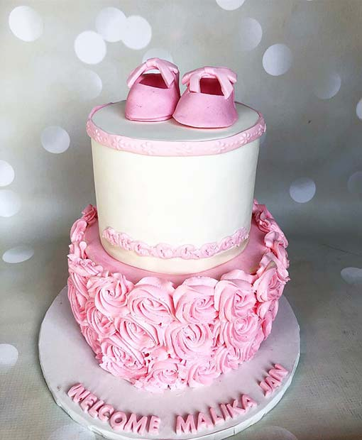 Pink and White Cake with Adorable Baby Shoes