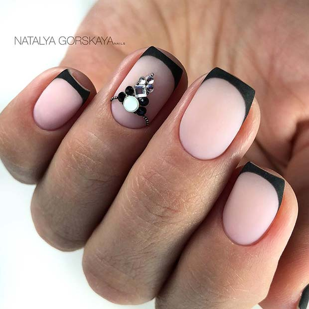 Short Nails with Black Tips and a Crystal Accent Design