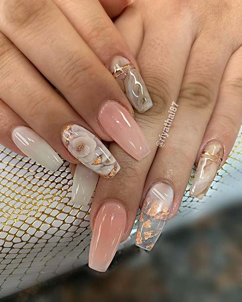 Trendy Coffin Nails with a Floral Accent Design