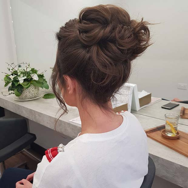 Chic High Bun with Relaxed Curls