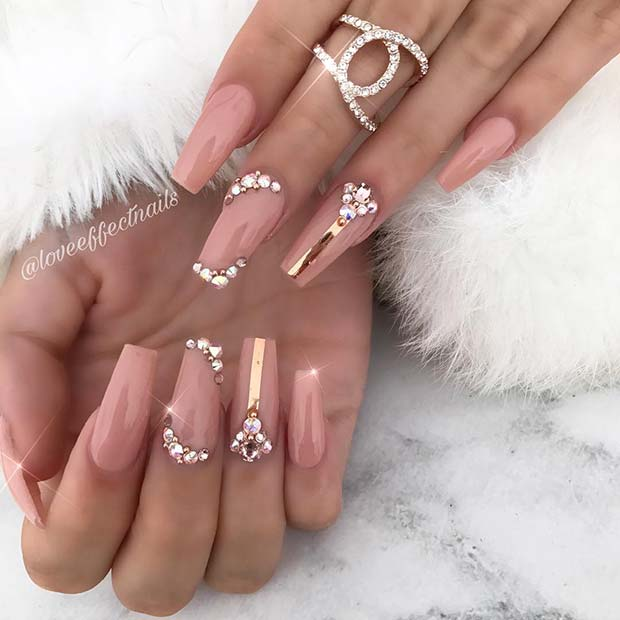 Chic Nude Nails with Crystals and Stripes