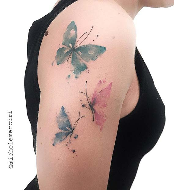 Delicate Butterfly Arm Tattoo