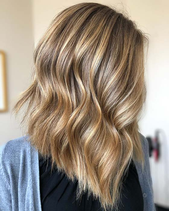Blonde Highlights with a Trendy Angle Cut