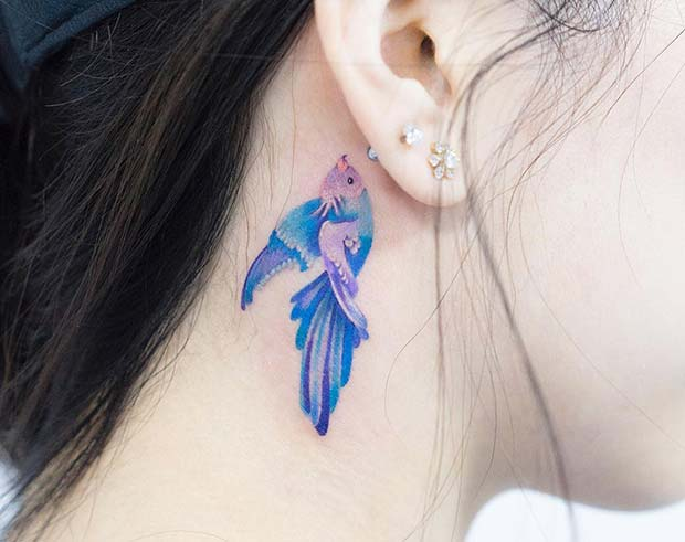 Pretty and Delicate Bird Tattoo