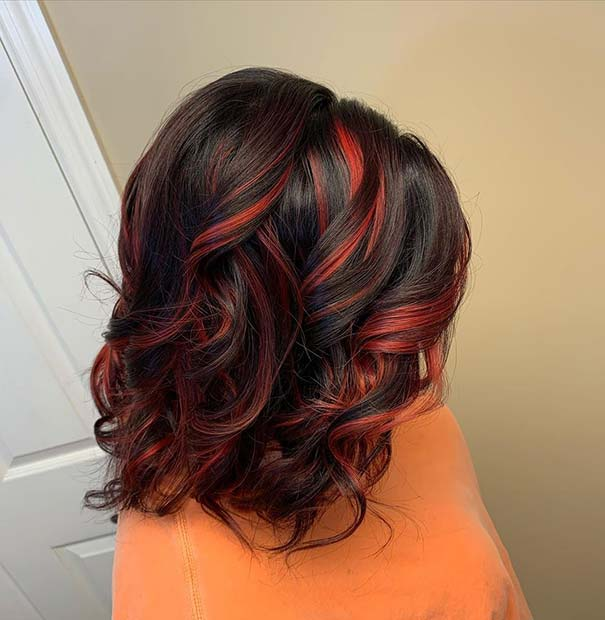 Black Hair with Cute Curls and Red Highlights