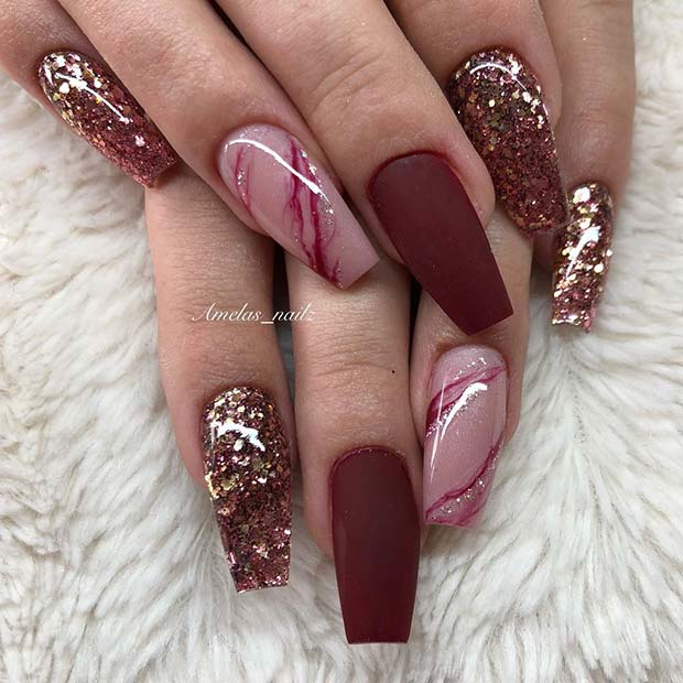 Matte Burgundy Nails with a Marble and Glitter Design