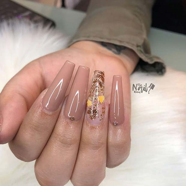 Nude Coffin Nails with a Beautiful Accent Nail