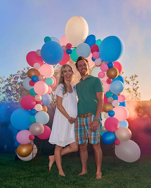 Pink and Blue Balloon Arch with Smoke