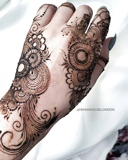 Beautiful Hand Henna with Flowers and Swirls