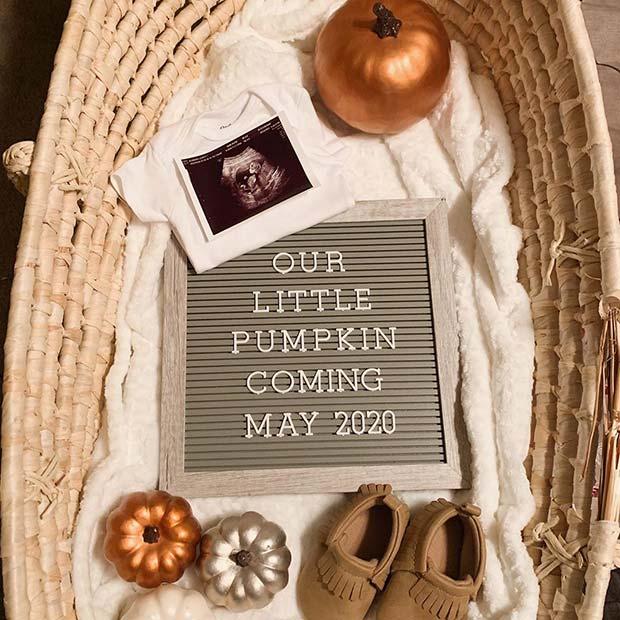 Pregnancy Announcement with Pumpkins