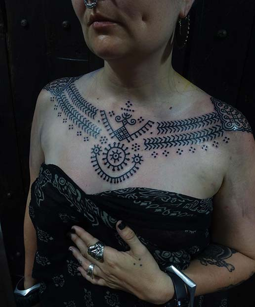 Statement Making Tribal Collar Bones and Chest Tattoo