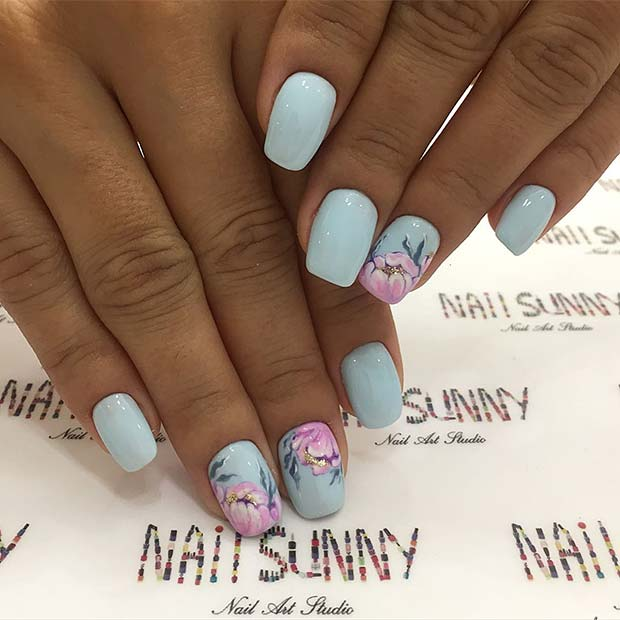 Gorgeous Blue Nails with Beautiful Flowers