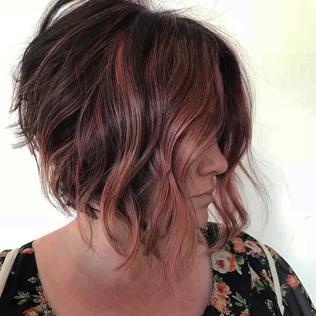 Bob Haircut with Layers and Red Highlights