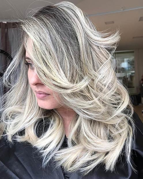 Medium Feathered Blonde Hair