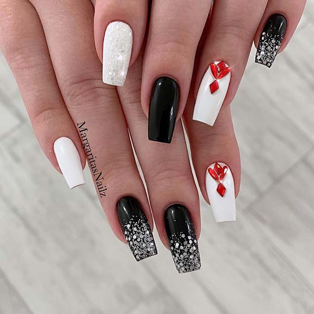 White and Black Nails with Red Rhinestones