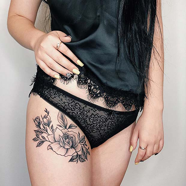 Beautiful Black Ink Flower Thigh Tattoo